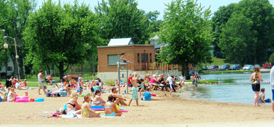 This photo shows people enjoying the beach at Center Lake. Maintaining water quality is important for continued enjoyment of lakes and streams in the Warsaw-area watershed. Individuals can help by providing input with water-related concerns to help develop a water quality improvement plan. (Photo provided)