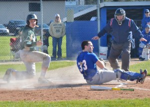 Rieder Hunley slides in safely at home for Wawasee.