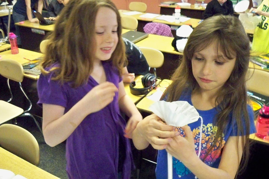 Triton Elementary students Ashlie Mc Andrews and Katie Reichard work on their Earth Day project together.