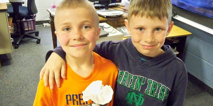 Triton Elementary students Nate Schuler and Isaiah Vaca present their finished 'bio-inspired flower.'