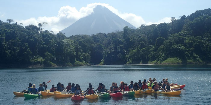 Students from Triton Jr.-Sr. High posing on a lake during their spring break trip to Costa Rica.