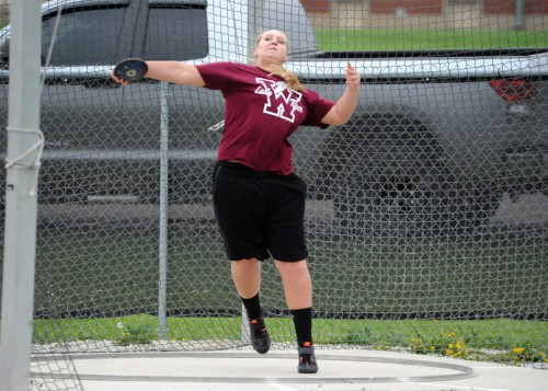 Warsaw's Emily Bailey lets loose on a discus attempt.