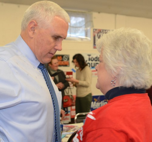 Gov. Mike Pence talks with Lynn Howie, county party chairman, after he arrived at the event.