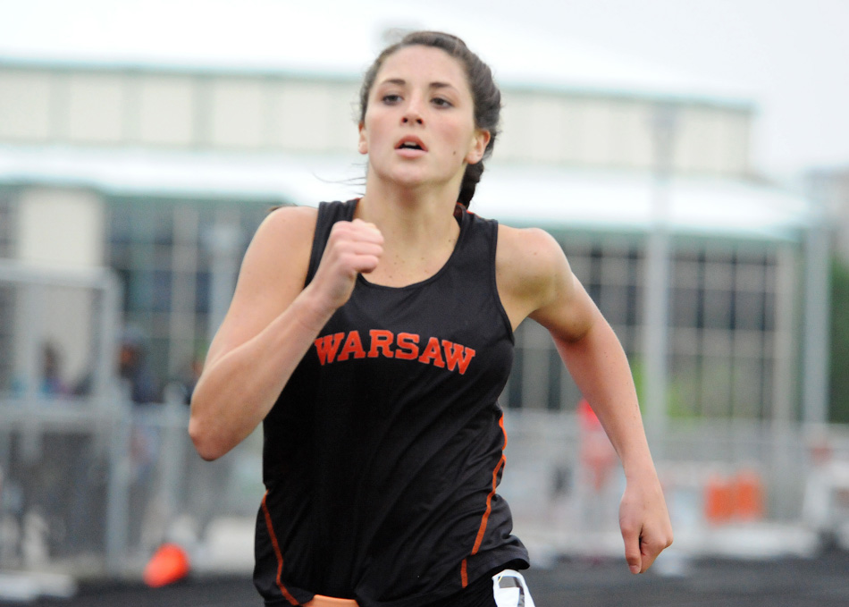 Warsaw's Kenzie Martz sprints to a win in the 800-meter dash Tuesday against NLC foes Concord and NorthWood. (Photos by Mike Deak)
