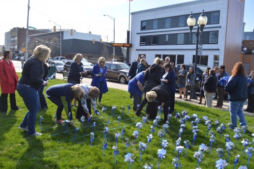Approximately 40 people came out to plant the first pinwheel garden on the south lawn of the Kosciusko County Court House. The garden was planted in honor of Child Abuse Prevention Month.