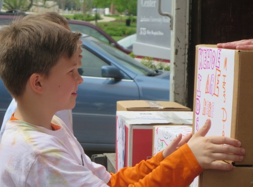 Milford student helps to unload books for the Kehoe Kids Project.