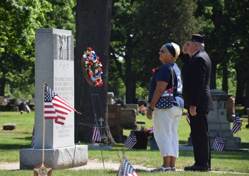 Connie Schlag, auxiliary president, and Commander Dexter Wise presented a wreath on Legion Circle 2 during the memorial service. (Photos by Maggie Kenworthy)