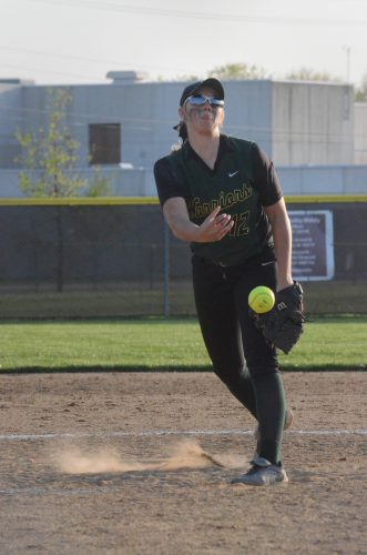 Meghan Frez fires a pitch for Wawasee Friday night. Fretz threw a one-hit gem as the Warriors beat host Elkhart Memorial 14-0 in NLC action.