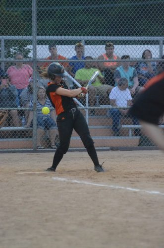 Grace Johnson fouls off a pitch for Warsaw.