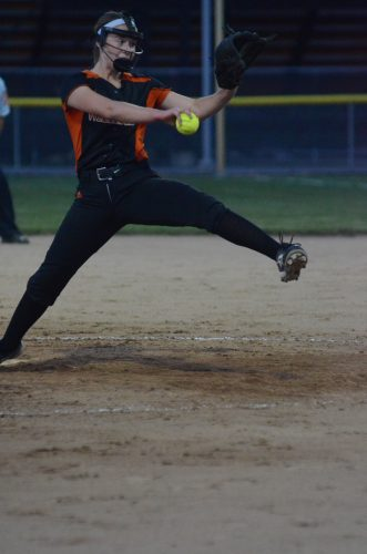 Freshman Courtney Chookie winds up to deliver a pitch for Warsaw in sectional action Tuesday night.