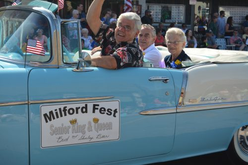 Milford Fest's 2016 Senior King and Queen Bud and Shirley Beer get an escort through town during the annual Memorial Day parade.