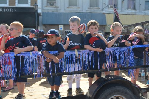 Members of the Milford Youth Baseball League enjoy the ride on their float during the 2016 Memorial Day parade.