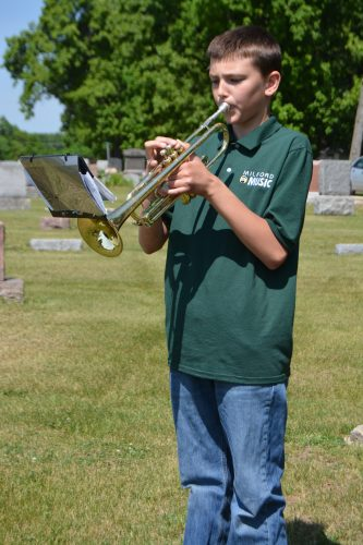 Milford Middle School seventh-grade student Griffin Noel performed Taps during the memorial ceremony held at Milford Cemetery on Memorial Day.