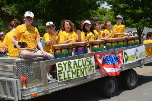 Members of the Syracuse Elementary School Drum Circle entertained parade watchers during the 2016 Memorial Day parade in Syrcause.
