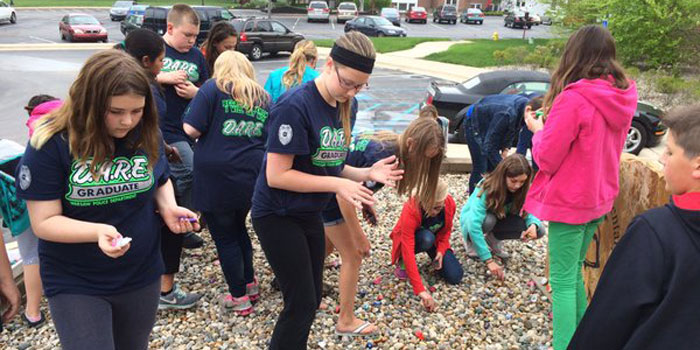 Jefferson Elementary students place rocks illustrating what kindness means to them. (Photos provided)