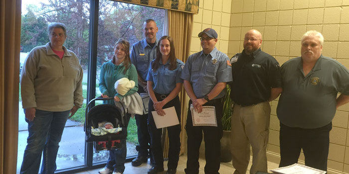 """Lutheran EMS dispatch and first reponders who responded to an """"in-home"""" birth, from left; Dispatcher Jeanne Thomas, Mother Brittany Prater with son, first responders Nathan Rhoades, Sarah Ellison and David Manuszak, Paramedic Darrell Sopher and Pierceton Fire Chief Gordon Baker"""