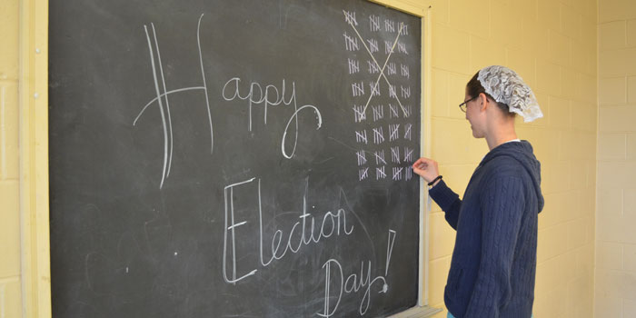 Poll worker Cassia Richardson adds another tally mark to the board at Etna Green's Heritage Park building. (Photos by Amanda McFarland)