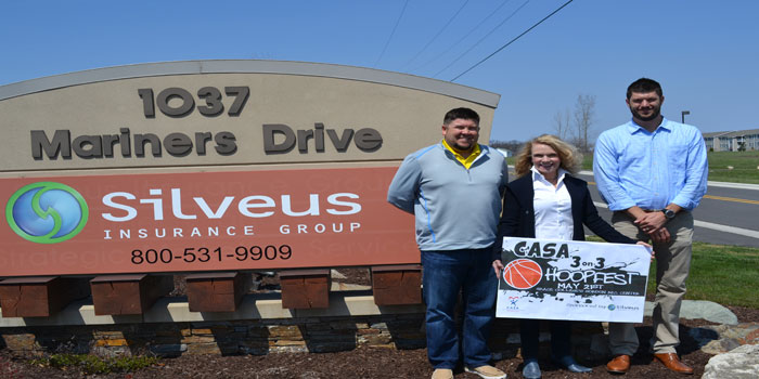 Pictured are Chris McCray from Silveus Insurance Group and member of the CASA Hoopfest committee; Jill Serbousek, CASA board member and Hoopfest committee member; and Tyler Silveus, CEO of Silveus Insurance Group.