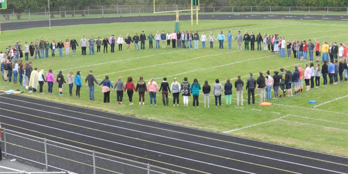 An FCA-led prayer event with the Bibler family, held in October, 2015. The student body gathered in the stands. (Photos provided)