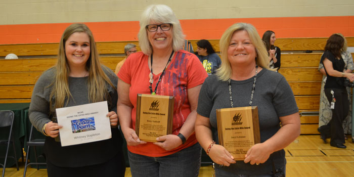 Three people received the Going the Extra Mile award in three categories. They were, from left, Whitney Stapleton in the student category, Betsy Sudhoff in the teacher category and Jeryl Leamon in the support staff category.