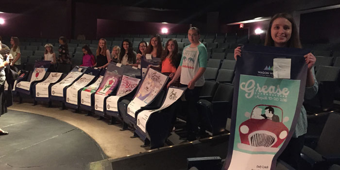 Warsaw elementary-school and high-school art students display the banners they designed for this summer's season at the Wagon Wheel Center for the Arts, Warsaw. (Photo provided)