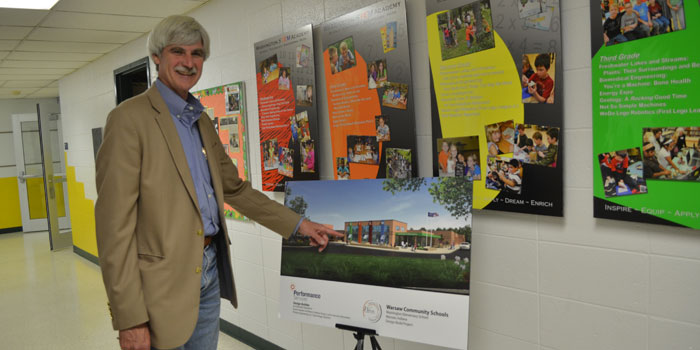 Jim Lemasters shows off a rendering of what Washington school will look like when construction is finished.