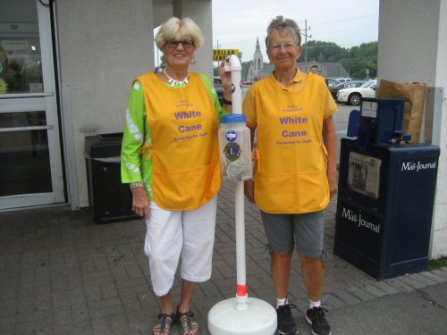 Syracuse Lions, Becky Fox and Suzanne Slabach, are pictured participating in a past White Cane Day. (Photo Provided)