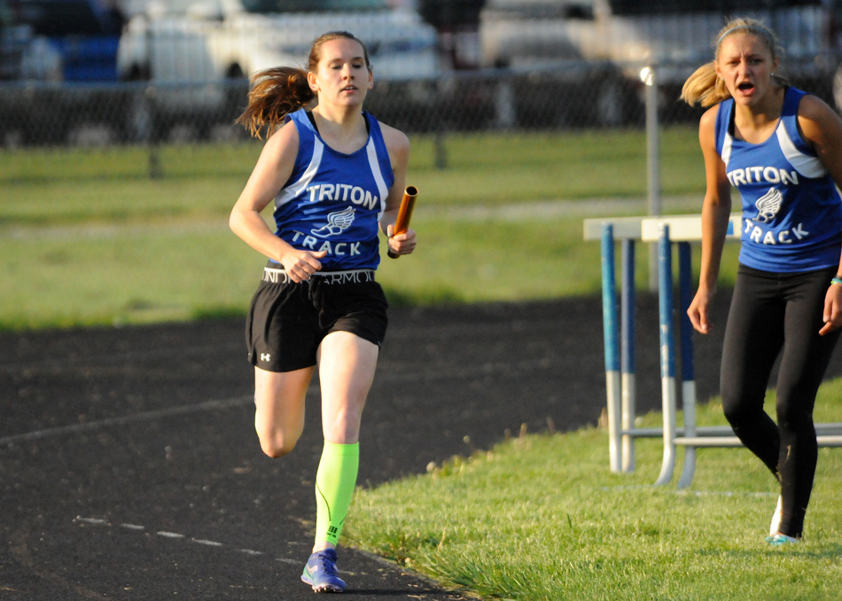 Baylee McIntire, running in the 4x400 relay, and Abigail Powell, right, had huge nights at the HNAC Girls Track Championships Wednesday at Knox. (File photo by Mike Deak)