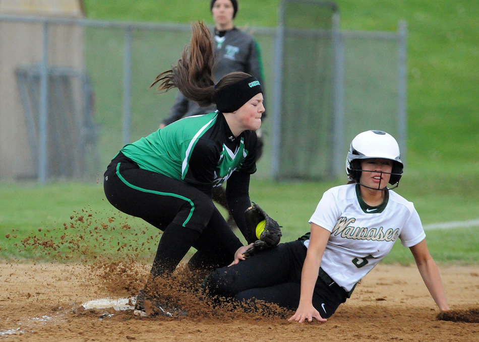 Wawasee's Cristina DeLaFuente slides under the tag attempt of Concord's Skylar Decker to complete a two-run triple.