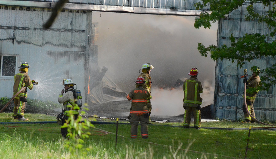 Firefighters battle the blaze. Photos by Deb Patterson