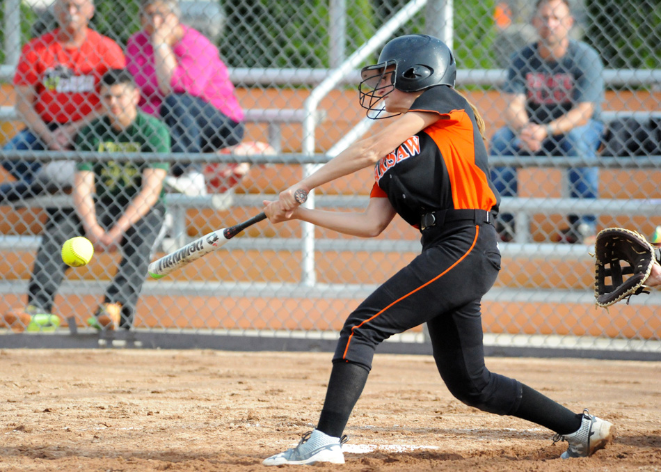 Warsaw's Sarah Shoemaker makes contact Wednesday against NorthWood. (Photo by Mike Deak)