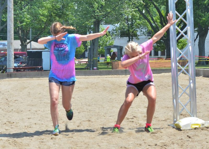 Ashley Bishop and Megan Metzger dab as they cross the finish line.