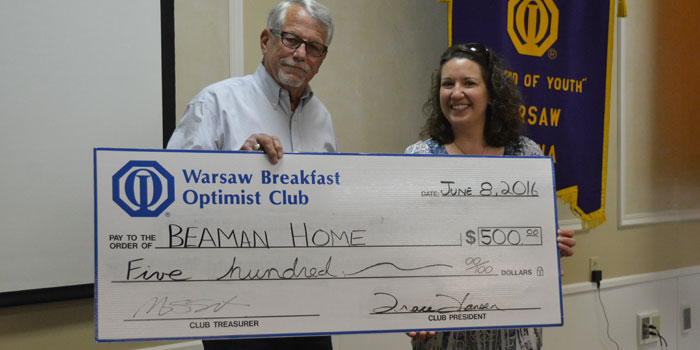 Picctured from the left are Art Gakstatter, representing the Warsaw Breakfast Optimist Club, and Tracie Hodson, representing The Beaman Home.