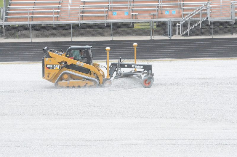 Construction crews were hard at work Wednesday on the field turf project at Fisher Field at WCHS.