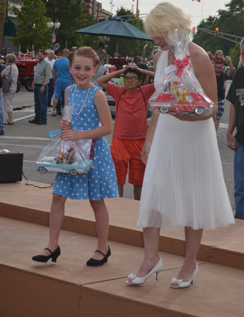 """Taylee Zorn, left, as """"Lucy"""" and Brittany Elliott as Marilyn Monroe enjoy their prizes. Elliott came in first and Zorn came in second."""