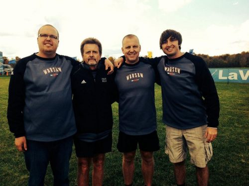 Matt Campbell, far right, poses with Rob Peters, Mills and Greg Davis when all four were coaching with the Warsaw boys cross country program in 2013.