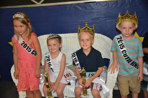 Seated are the 2016 Cutie Queen and Addyson Thomas and Gidieon Cook. They are flanked by the 2015 Cutie Queen and King Jozie Mishler and Kohen Tom.