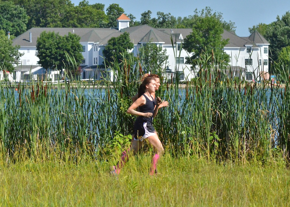 Linda and Isabelle Moore jog side-by-side near the shore of Lake Wawasee during Saturday's Mudtastic Classic. (Photos by Nick Goralczyk)