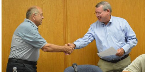 Town Attorney Vern Landis congratulates Larry Martindale after swearing him in as the new councilman. Martindale is representing Ward 4, replacing Brian Woody, who stepped down last month. (Photo by Lauren Zeugner)