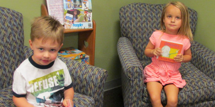 From the left, Brody Maisonneuve and Delaney Tranter visited the North Webster Library with the North Webster Daycare to sign up for the Summer Reading Program.