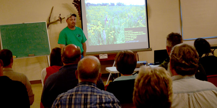 Scott Fetters answers questions following his presentation on pollinators and pollinator habitat.