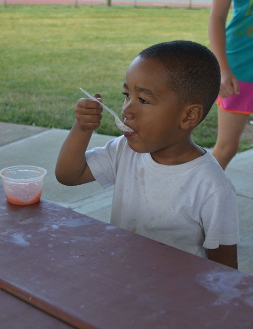 Kacin Wilson finishes off his strawberry applesauce.
