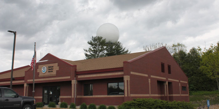 The bubble at the top of the hill is the Doppler radar at the National Weather Services office. The radar was placed on the State Road 13 location because it is the highest point in the area. Individuals are welcome to sign up and join the Syracuse Library for a June tour of the facility.