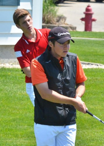 Warsaw's Tim Rata (front) checks out his drive at the NLC championship with Plymouth's Hudson Yoder watching from behind. (Photo by Nick Goralczyk)