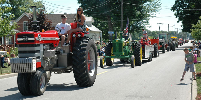 Tractors driving through Main Street in Silver Lake at the Silver Lake Days.