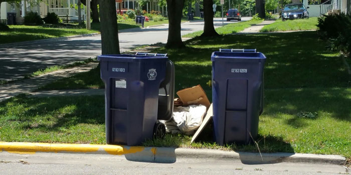 Residents have expressed concern over recent changes in Warsaw's trash pickup ordinance. (Photos provided)