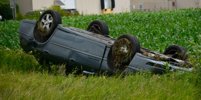 Vehicle flipped on the east side of the road, just south of Levi Lee Road.