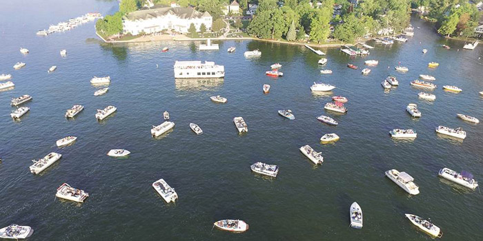 A drone shot captures an assemblage of worshipers at a 2015 Lake Wawasee boat-in service. (Photo provided)
