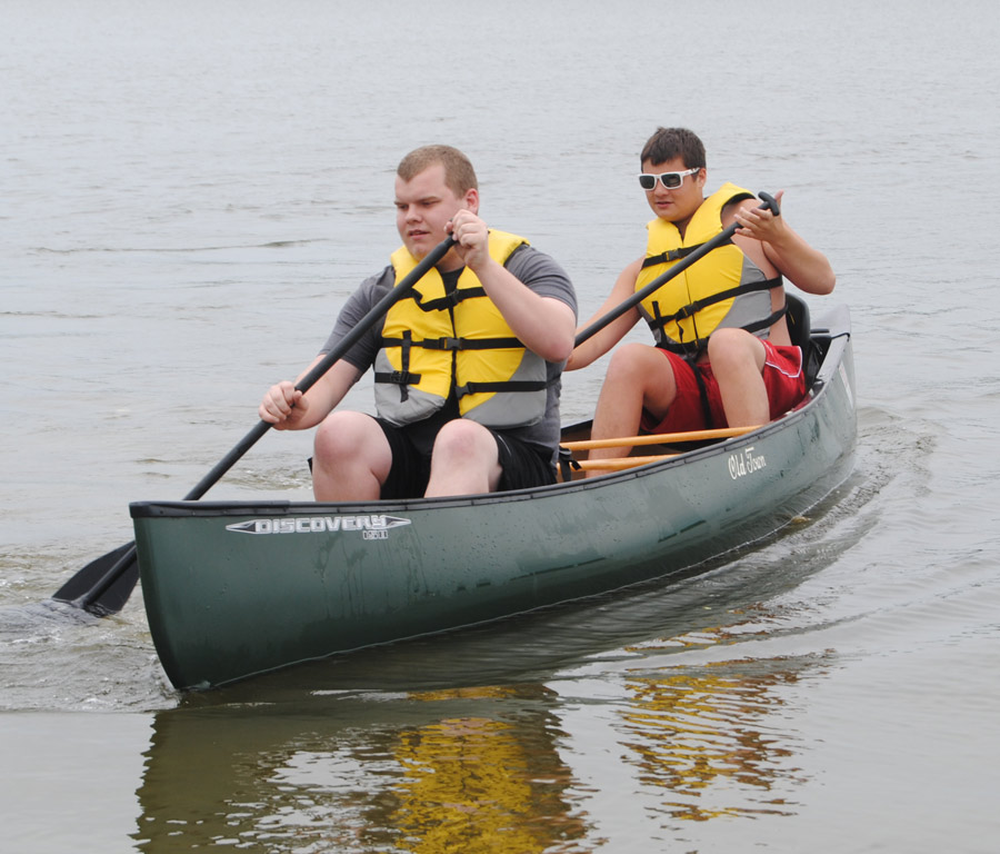 Center Lake Beach, Warsaw, offers free canoeing during the summer months. Pictured canoeing are Dylan Schaefer and Kaleb Schneidewent.