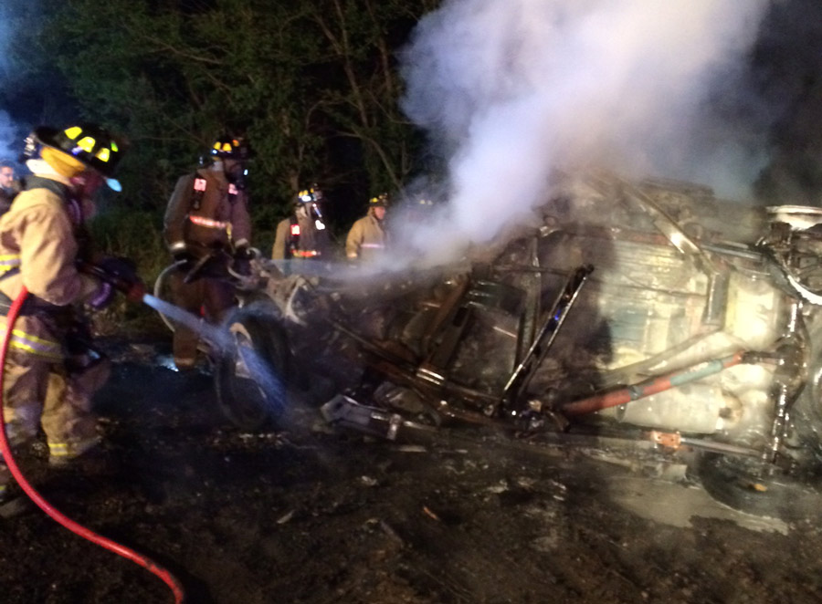 Firefighters extinguish the fire at a fatal crash scene. (Photo provided)
